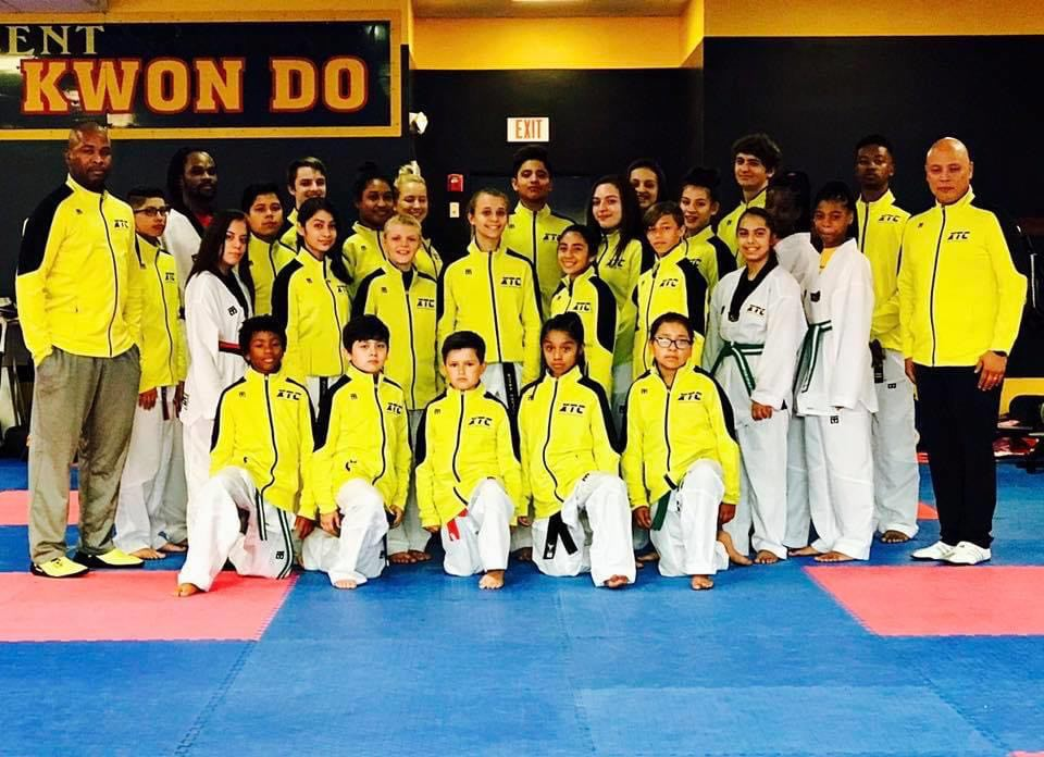 martial arts students in team jackets