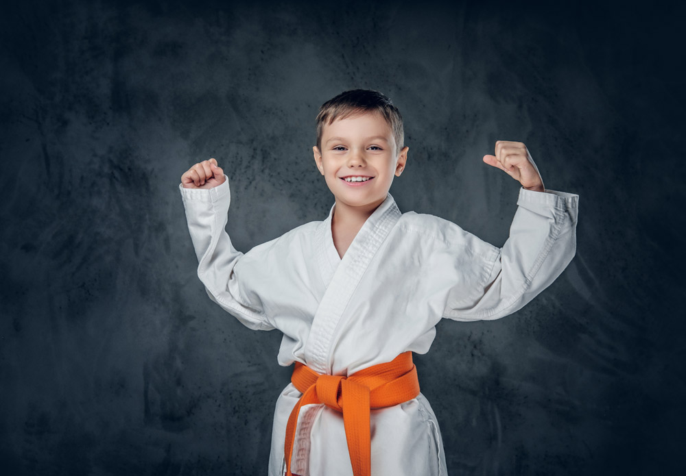 karate student with hands up